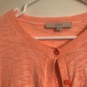 An orange sweater.